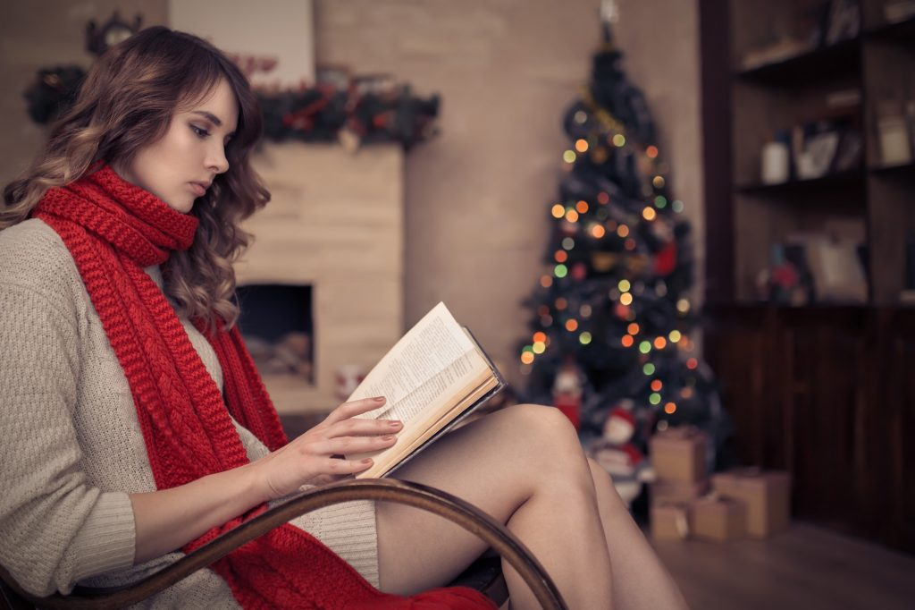 Woman Reading A Book. Christmas.
